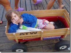 Emily lying down in the wagon