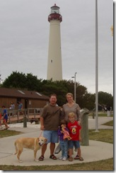 Family and the dog by the lighthouse