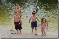 The kids and Devin at the lake